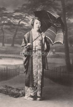 Woman in Kimono with Western umbrella. Old Japan