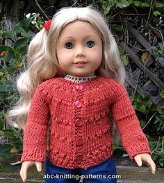 My doll needed something warm to wear with her blue jeans this fall, so I knitted this country-style cardigan.