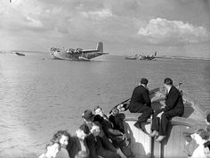 Flying boat and small seaplane at Foynes.    Photograph taken July 1938.