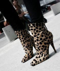 leopard booties... reminds me of cruella devil