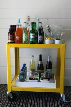 Love this!  Turn an old school a/v cart into a side table or a drink stand.