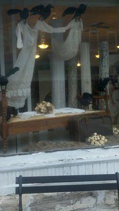 Halloween Windows: Ravens holding sheers, distressed columns