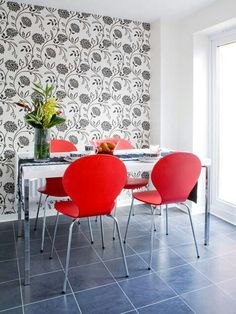 Love the wallpaper/red chair combo