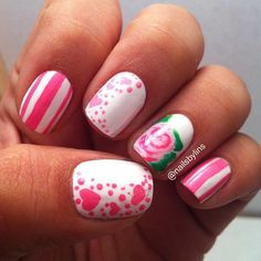 An endearing pink nail art design. You can see a variety of combinations such as pink polish in stripes, bursting hearts and flowers.