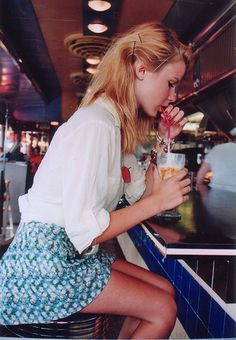 a simple white blouse and a mini floral skirt makes any look complete