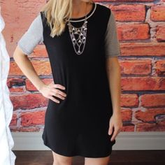 "Block Short Sleeves Dress Colors are black and grey. Brand new with tag. 62.7% polyester 33.8 rayon 3.5 spandex. Measurement Laying Flat: Bust: 19"" Length: 35"" Boutique Dresses"
