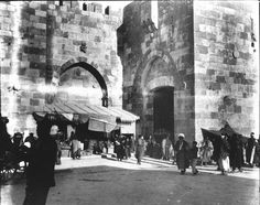 Jerusalem. The Jaffa Gate [Exterior view of gate in centre of W side of city wall. Also called Bab el Khalil (Hebron Gate) by Arabs because road to Hebron starts here. Townspeople and market in foreground]