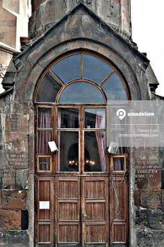 Beautiful wooden door on a stone church in Yerevan Armenia.