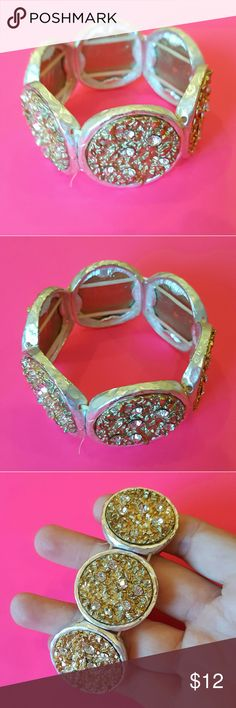 Stretchy Gold Rhinestone Bracelet Stretchy bracelet with several gold & rhinestone decorated discs. In excellent condition.  Comes from a smoke free home! I always ship same or next day :) Jewelry Bracelets