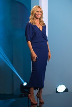 Heidi Klum looks beautiful in her blue dress and matching red heels. For more of Heidi's looks, tune in to Project Runway on Lifetime on Thursdays at 9/8c!