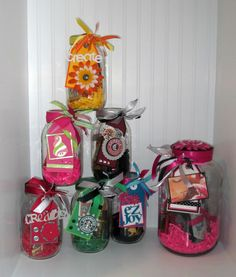 Use a mason jar...add shredded paper, chocolates, a gift card, and some cute embelishments! I made these for door prizes for our scrapbooking weekend :)