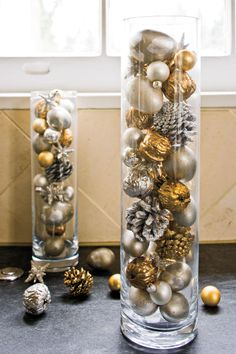 Fill Cylinders with Ornaments - 100 Fresh Christmas Decorating Ideas - Southernliving. Use spray paint to add a shimmery touch to pinecones, acorns, or round glass ornaments. Displayed en masse in tall glass vases, they become instant and easy Christmas accents.    Glass Cylinder Vases: Crate