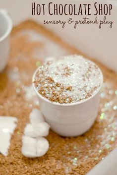 Let kids open up a hot chocolate shop for some Winter fun- pretend play & sensory exploration perfect for Winter