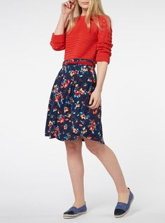 £14 Embrace the warmer seasons with this skater skirt, featuring a charming floral pattern, button front and stylish woven belt. Added stretch provides it with a flowing silhouette. Navy belted skater skirt Woven string belt Elasticated waistband Stretch fabric Button detail on the front Model's height is 5'11