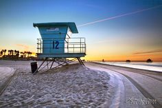 """""""Lifeguard Stand #12"""" by TravLin Photography - Huntington Beach Sunrise Lifeguard Tower Photo - Beach Wall Art Home Decor. A view of Lifeguard Stand #12 in front of the HB Pier in Huntington Beach, California. This early morning beach photography seascape features a lifeguard stand on the empty beach just before sunrise. This California sunrise photo is printed on professional-grade kodak endura paper with a lustre finish...."""
