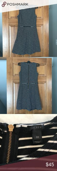 J Crew striped pointe skater dress Gently used. Gorgeous pointe knit skater style dress. J Crew. Black and white ivory stripes. High crew neck, exposed zipper at back. Size 00. J. Crew Dresses