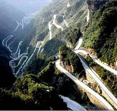 Big Gate Road or the Avenue Toward Heaven is located in Hunan province, the road is long from top to bottom. The highest point is ft) above sea level, and the lowest point is ft). The road took eight years to finish with work starting in and finishing in The Road, Zhangjiajie, Beautiful Roads, Beautiful Places, West Usa, Tianmen Mountain, Dangerous Roads, Winding Road, Places To See