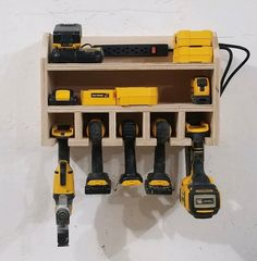 This wall mounted cordless tool station keeps your tools ready for action and fully charged. Do you or a loved one have power tools spread out all over and it takes longer to find the tool then the actual job. When you do find the tool the battery isnt changed, then this is for you. This tool Организация Инструментов, Хранение Вещей В Мастерской, Электроинструменты, Идеи Для Хранения, Хранение Пиломатериалов, Шкаф Для Хранения Инструментов, Размещение Инструментов, Гараж Верстак, Гараж Переделка