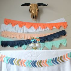 This set includes matching sets of 12 cupcake toppers, 6 foot long banner and set of 5 six foot long tissue garlands in variety of fringe cuts. Listing is for set as shown in images. Colors used are coral, white, peach, navy blue, mint and metallic gold in paper. Any questions about individual products, see separate listings for more details. Want to customize this set? Purchase these items individually to create your custom party for your wild one.