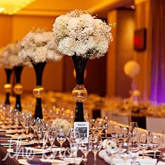 Black & white tall centerpieces and long tables. Modern, Minimal and trendy. Love love love!