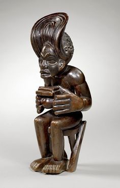 Statue of a man playing a thumb piano , Sanza, from the Chokwe people of Angola | ca. 19th century | Wood and hair | Africa
