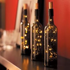 For each bottle, you need a single-plug strand of 20-25 lights. Feed the non-plug end into the drilled hole, leaving a length of cord extending from the opening.