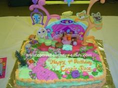 Littlest Pet Shop cake: This Little Pet Shop cake was made for my daughter's 9th birthday. She had The Littlest Pet Shop theme. It was my daughter's idea to have a cake that would