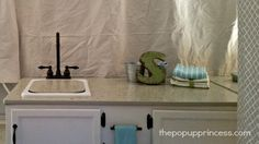 Love the little spot to hang the towel. Pop Up Camper Kitchen