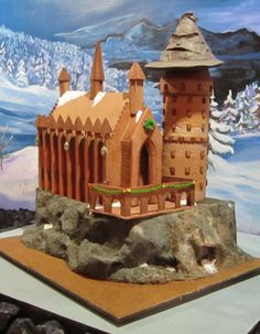 "Adult Division - ""Hogwarts Castle at Christmas."" Materials used: gingerbread, frosting, fondant, melted hard candies. (2013 entry)"