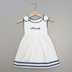 Hey, I found this really awesome Etsy listing at https://www.etsy.com/listing/130606370/girls-white-and-navy-blue-pique-dress
