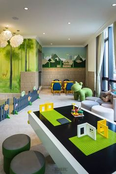 A nice fenced in area could be good for infants.   And a lego table would be useful for the older kiddos. but the small pieces would be a problem for the younger ones.