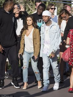 Tyga's new girl Demi Rose teases her assets in low-cut T-shirt