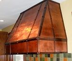 Handcrafted copper kitchen hood. Bring a rustic and modern look to your kitchen.
