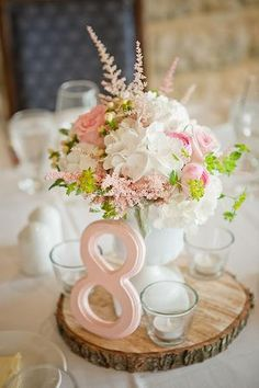 Gorgeous and soft centrepiece filled with blush and pale pink garden roses, blush satiable,  pale pink ranunculus, white hydrangeas, and bulperum. http://www.sugarbloom.ca