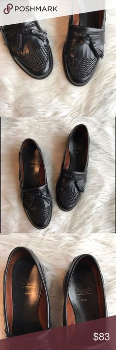 Allen Edmonds - 'Cody' Tassel Loafers black 10 ½ Allen Edmonds Black leather 'Cody' Tassel Loafers. Made in the USA by hand. Calfskin leather upper, leather lining and sole. Charming full grain leather shoes. In excellent condition. Size 10 ½ B. (The B is a narrow size). Woven plug. Braided leather. A cork midsole molds to the foot for custom comfort. Allen Edmonds Shoes Loafers & Slip-Ons