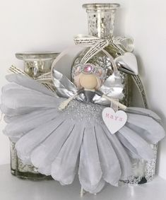 Christmas Fairy. It's the Most Wonderful Time of the Year! This handmade fairy is ideal for any tree and is totally unique. This fairy doll in grey/silver measures approximately 15 cm tall from her head to her toes. A little heart shaped 'bag' displays the recipient's name. Each fairy is made from a wooden bead, embroidery floss, an artificial flower, flower petal wings and embellishments. This fairy has a ribbon on her back for hanging. She is delicate and NOT intended for use as a toy. Doll Crafts, Cute Crafts, Diy Doll, Christmas Fairy, Christmas Angels, Christmas Crafts, Flower Fairies, Flower Petals, Ballerina Ornaments