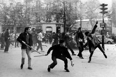 Bruno Barbey - France. Paris. 6th arrondissement. Boulevard Saint Germain. May 6th 1968. Students hurling projectiles against the police., Photograph