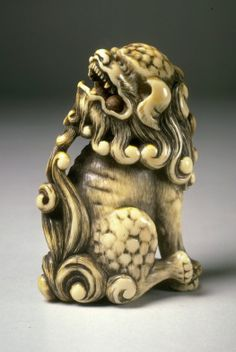 Carved Ivory Guardian Netsuke