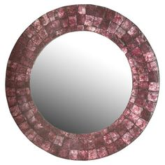 Add a pop of style to your entryway or master suite with this eye-catching capiz wall mirror, showcasing a round silhouette and purple finish.