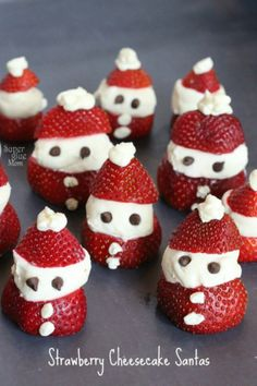 Strawberry cheesecake Santas that are delicious and a fun food-craft with kids via Superglue Mom!