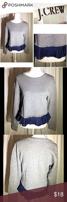 J. Crew gray sweater with navy ruffles Gray scoop-neck sweater with navy ruffles. Size M. Sweater:100% cotton and trim: 100% polyester. In great condition! J. Crew Sweaters Crew & Scoop Necks