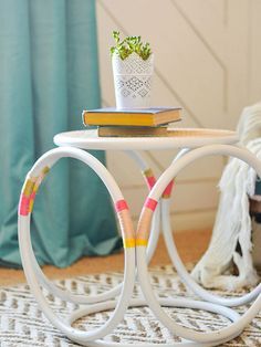 Division: Chairs and Side Tables Blogger: Mandi, Vintage Revivals About the Project My thread-wrapped stool is a simple DIY project that anyone can re-create and customize. I found the bentwood wicker stool at a thrift store for $12 (score!). After a coat of white spray paint, I wrapped sections of it with embroidery thread. This out-of-the-box DIY is such a happy addition to the office makeover I did for beauty blogger Maskcara. Click here for the full how-to.   Meet Mandi Mandi Gubler of…