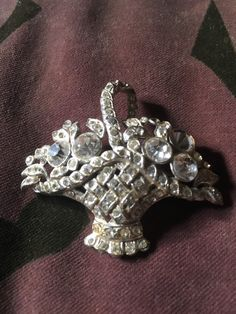 Vintage Basket brooch circa 1960s Diamante clear stones on a silver tone background by AimeEncore on Etsy https://www.etsy.com/uk/listing/449163324/vintage-basket-brooch-circa-1960s