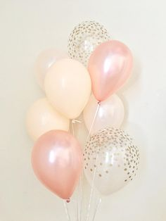 Welcome to Sweet Escapes By Debbie This listing is for 2 rose gold, 2 blush, 2 pearl peach and 2 clear with gold polka dots 11 latex balloons. ~ Balloons ship flat & deflated ~ The balloons arrive in a flat package they need to be inflated. For helium you can take them to your
