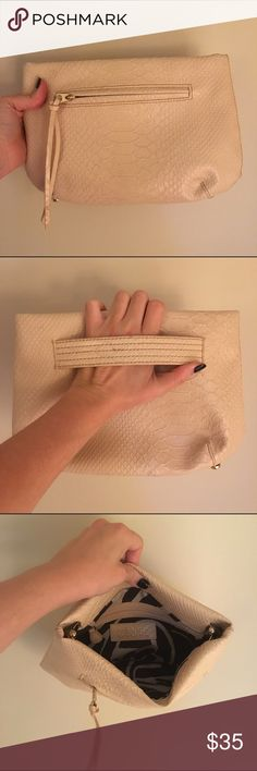 Cream snake print clutch Cream/light blush color clutch, with embossed snake print design. Zip pocket, snap closure, with another zip pocket inside. Medium size, can hold phone, keys, makeup, and a few small things easily. Very light wear. Korto momolu  Bags Clutches & Wristlets