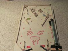 Homemade pinball board....cheaper and will keep the boys busy for awhile