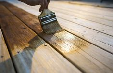 How to stain wood. Give your dull hardwood floors or wood furniture new life with a fresh coat of wood stain. This step-by-step guide on how to stain wood breaks it down. Grey Deck Stain, Deck Stain Colors, Deck Colors, Restain Deck, How To Restain Wood, Deck Staining, Cool Deck, Diy Deck, Grey Wood Floors