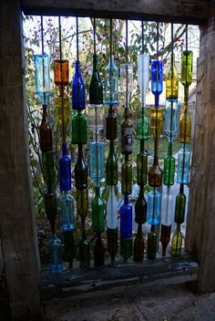 wine bottles were threaded onto pieces of rebar, making a unique and whimsical privacy screen