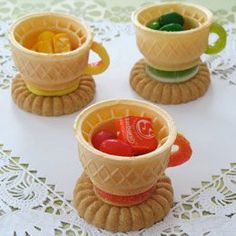 Edible teacups! Cup-style wafer ice cream cone, Round sugar or shortbread cookie, Decorator's icing to glue 1 gummy rings candy on cookie and  1 cut into handle shape, Asst candies, popcorn, or trail mix to fill the teacup