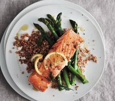 Lemony Baked Salmon With Asparagus and Bulgur | Trying to cut back? These tasty dinners all clock in at less than 400 calories per serving.